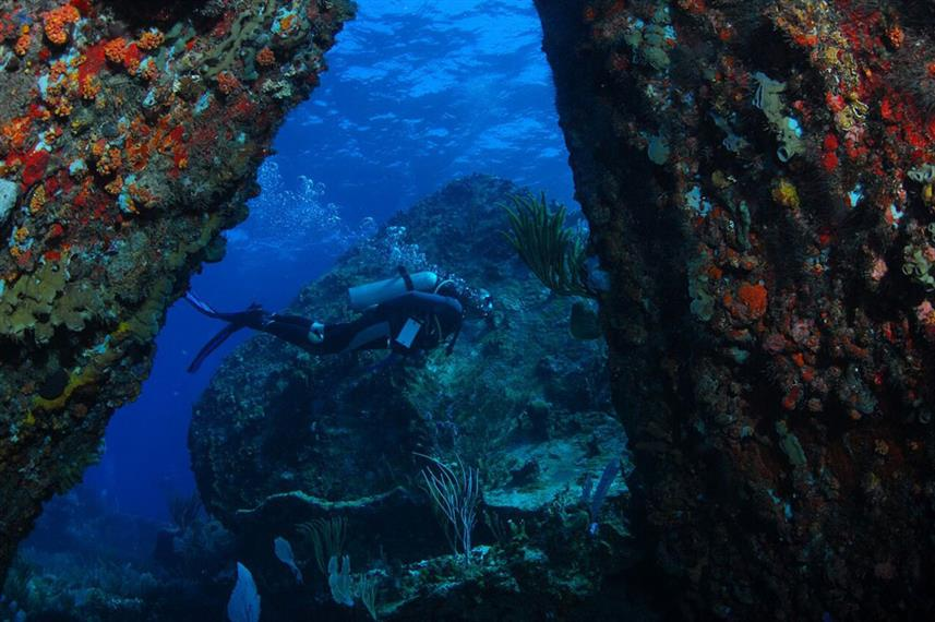 Diver Between Boulders - Scuba Diving the BVI